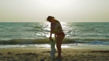 Happy Mother Spinning Her Small Baby Around At The Beach — Stock Video