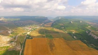Birds Eye View Of Hilly Locality And Harvest Field — Stock Video