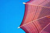 Thailand pattern silk umbrella and sky blue art artist handicraft beach. — Stock Photo