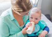 Cute baby brinking from a bottle — Stock Photo