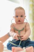 Cute baby listening to a stethoscope — Stock Photo