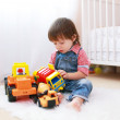 Little boy plays cars at home — Stock Photo #55967937