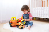 Little boy plays cars at home — Stock Photo