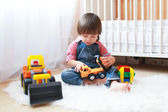 2 years toddler boy plays cars at home — Stock Photo