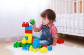 Lovely toddler playing constructor at home — Stock Photo