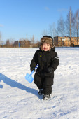 Lovely 2 years toddler walking with shovel in winter  — Stock Photo