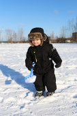 Lovely 2 years toddler with shovel in winter — Stock Photo