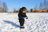 2 years little boy walking with shovel in winter — Stock Photo