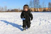 Lovely little boy with shovel in winter — Stock Photo
