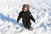 Smiling toddler walking in winter — Stock Photo
