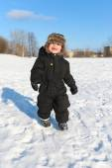 Happy 2 year toddler walking in winter — Stock Photo