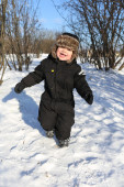 Lovely 2 years toddler running in winter  — Stock Photo