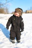 Smiling toddler walking in winter outdoors — Stock Photo