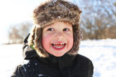 Portrait of smiling toddler walking in winter outdoors — Stock Photo