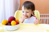 22 months baby eating fruits — Stock Photo