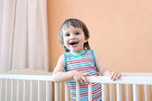 Smiling 2 years toddler in white bed — ストック写真