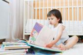 Toddler reading books — Stock Photo