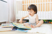 2 years toddler reading books — Stock Photo