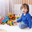 Lovely 2 years boy plays cars at home — Stock Photo #57463583