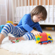 Lovely 2 years toddler boy plays cars at home — Stock Photo #57463637