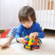 Lovely little boy plays cars at home — Stock Photo #57463643