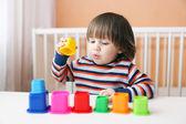 Little boy playing plastic blocks — Stock Photo