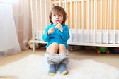 Lovely 2 years boy sitting on potty — Foto de Stock