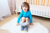 Lovely little boy sitting on potty at home — Foto Stock