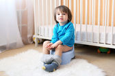 Little boy sitting on potty — Stock Photo