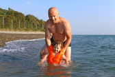 Father teaching  to swim his 2 years son — Stock Photo