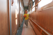 Little boy with ball in the train — Stock Photo