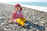 2 years boy sitting on the seaside — Stock Photo