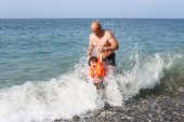 Father and his little son swimming in the wave sea — Stock Photo