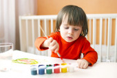 2 years boy with brush and gouache paints at home — Stock Photo
