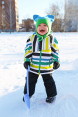 Happy toddler with shovel in winter outdoors — Stock Photo