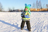 Lovely 2 years toddler with shovel in winter outdoors — Stock Photo