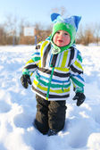 Lovely little child walking in winter outdoors — Stock Photo