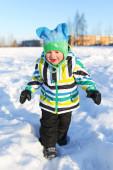 Happy toddler walking in winter — Stock Photo