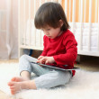 Little boy in red shirt with tablet computer — Stock Photo #63380443