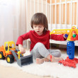 Lovely toddler boy plays cars — Stock Photo #63381069