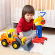 Lovely 2 years toddler boy plays cars at home — Stock Photo #63381071
