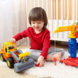 Lovely toddler boy plays cars at home — Stock Photo #63381091