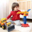 Lovely 2 years toddler boy plays cars — Stock Photo #63381135