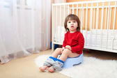 Lovely 2 years child sitting on potty — Stock Photo
