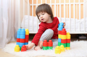 2 years toddler playing plastic blocks at home — Stock Photo