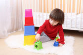 Little boy playing with educational toy at home — Stock Photo