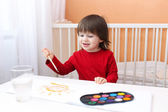 2 years child painting with water color paints — Stock Photo