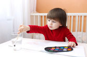 Little child painting — Stock Photo