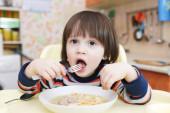 Little boy eating soup — Stock Photo
