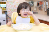 Whimsical little boy dont want to eat quark with sour cream — Stock Photo